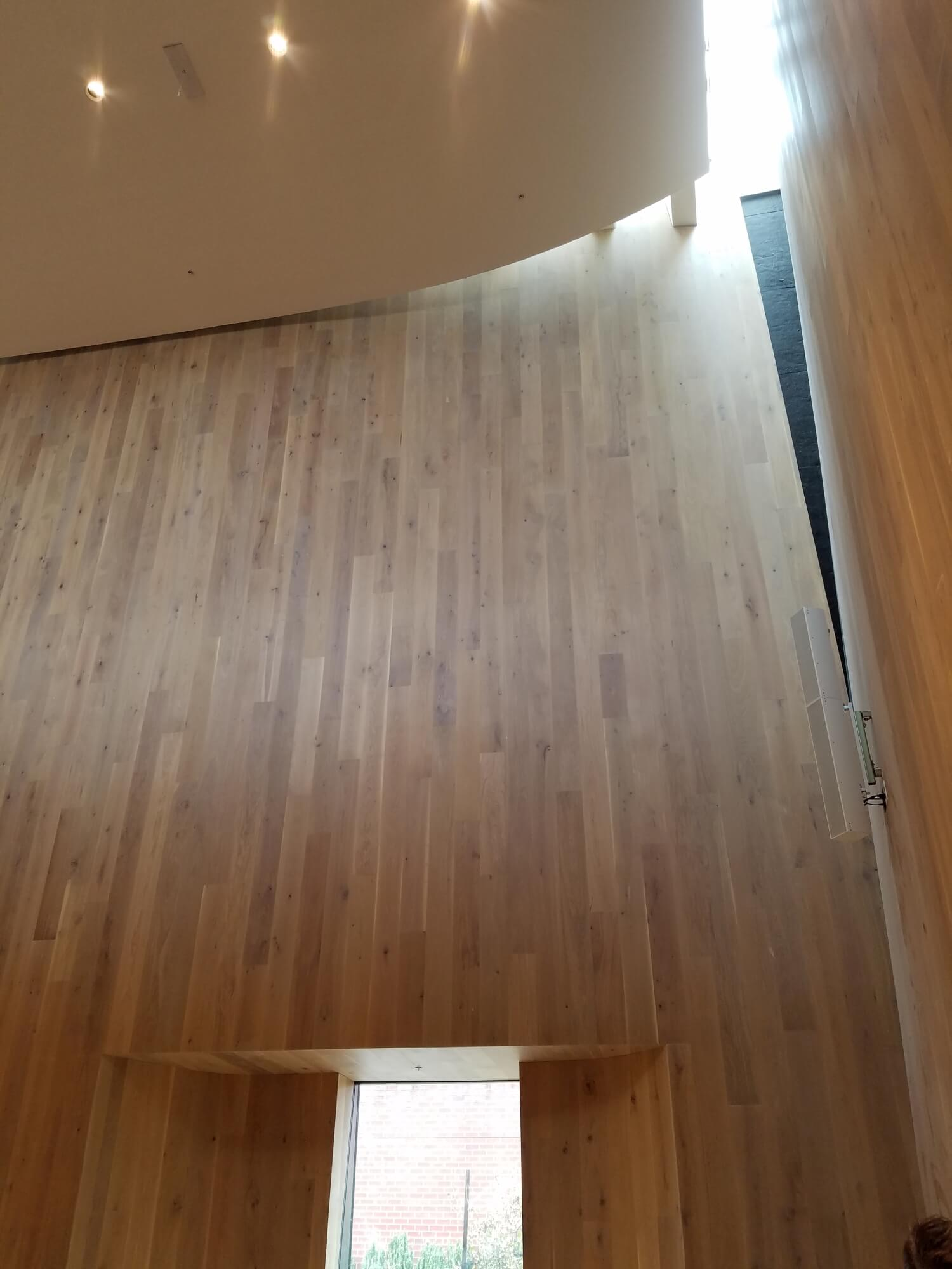 University of Oregon concert hall has white oak walls curved out to direct sound upwards.