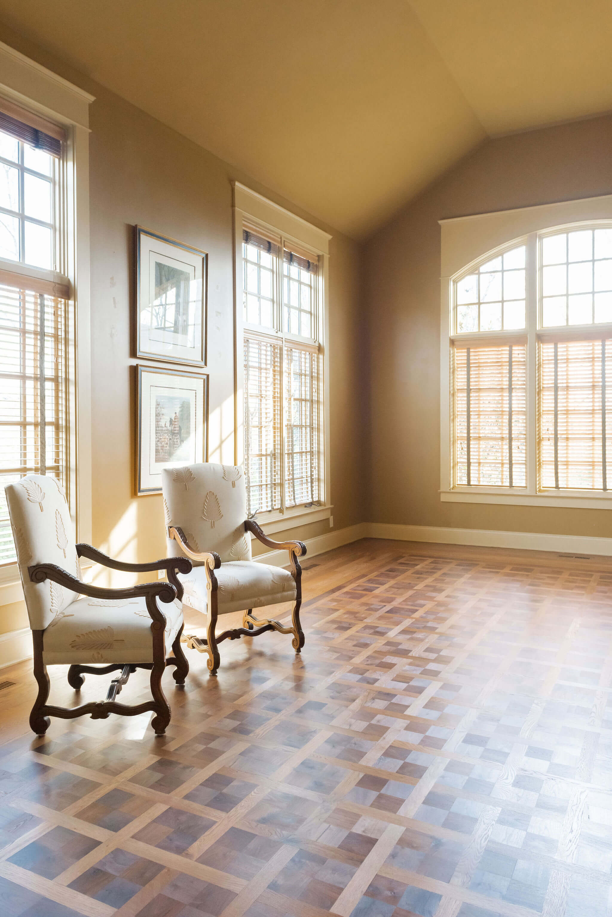 Beautiful lighting accentuates a stunning parquet floor finished with a hardwax oil finish.