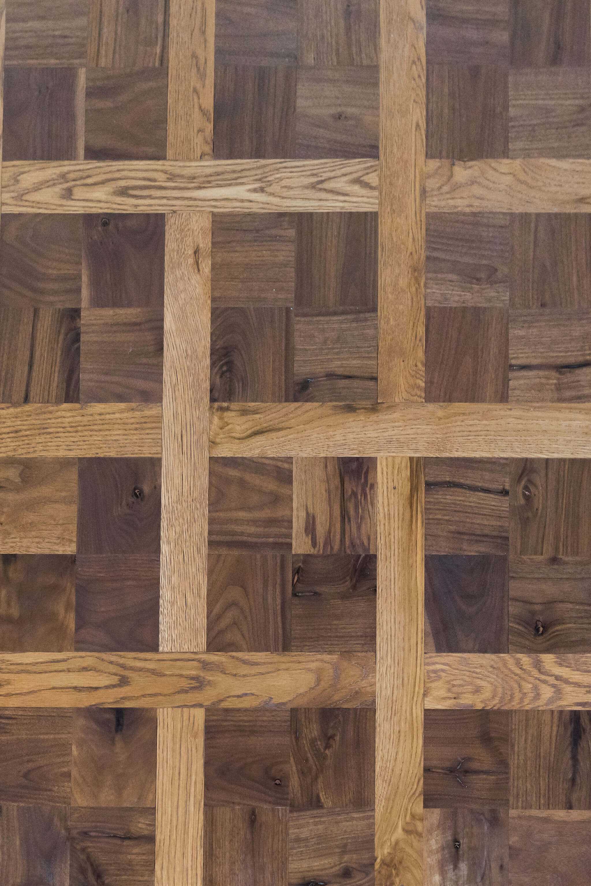 Detailed look at a white oak and walnut parquet floor finished with Rubio Monocoat.