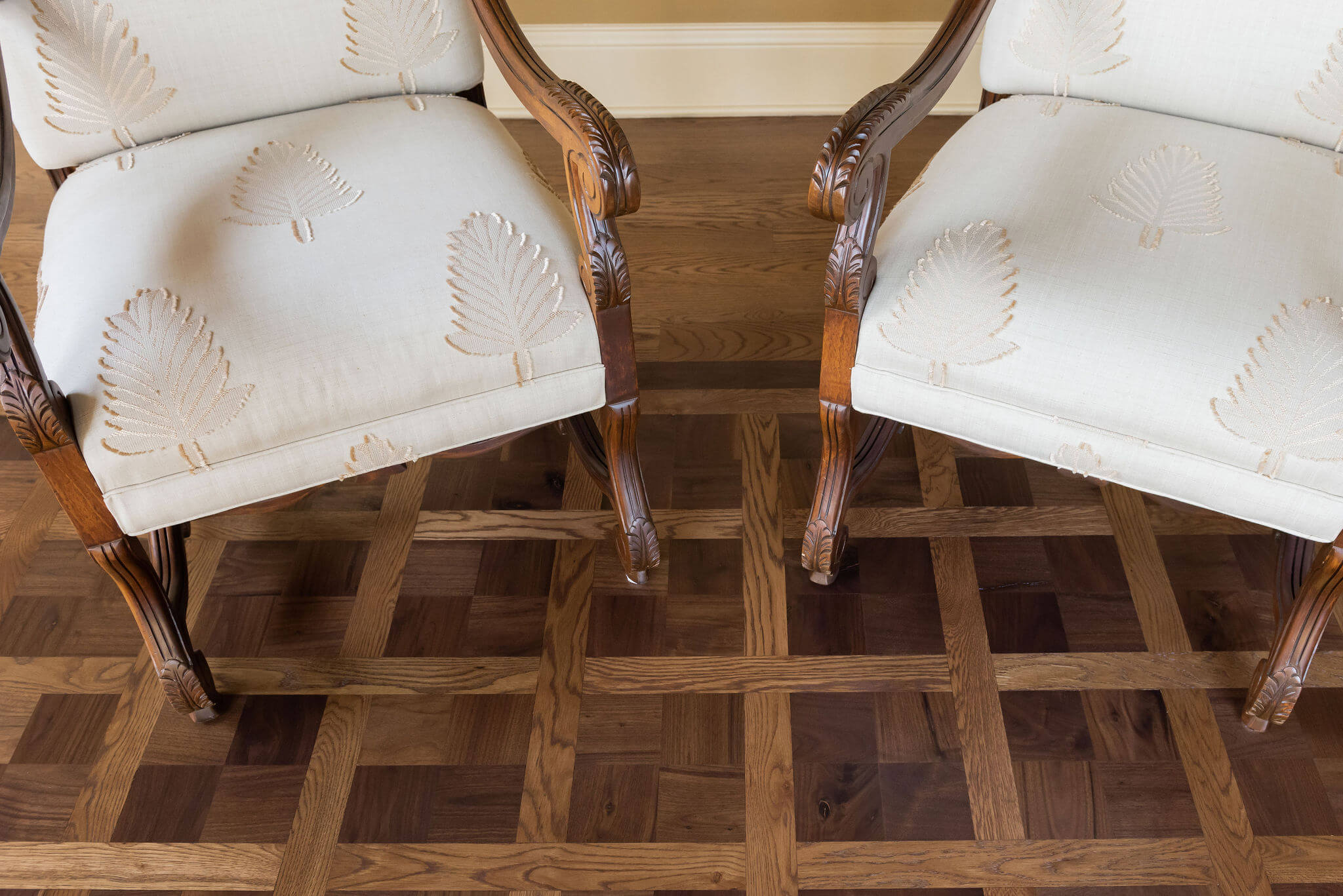 Chairs on a parquet wood floor finished with Rubio Monocoat.