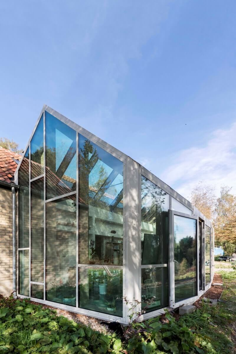 Glass sun room attached to house.
