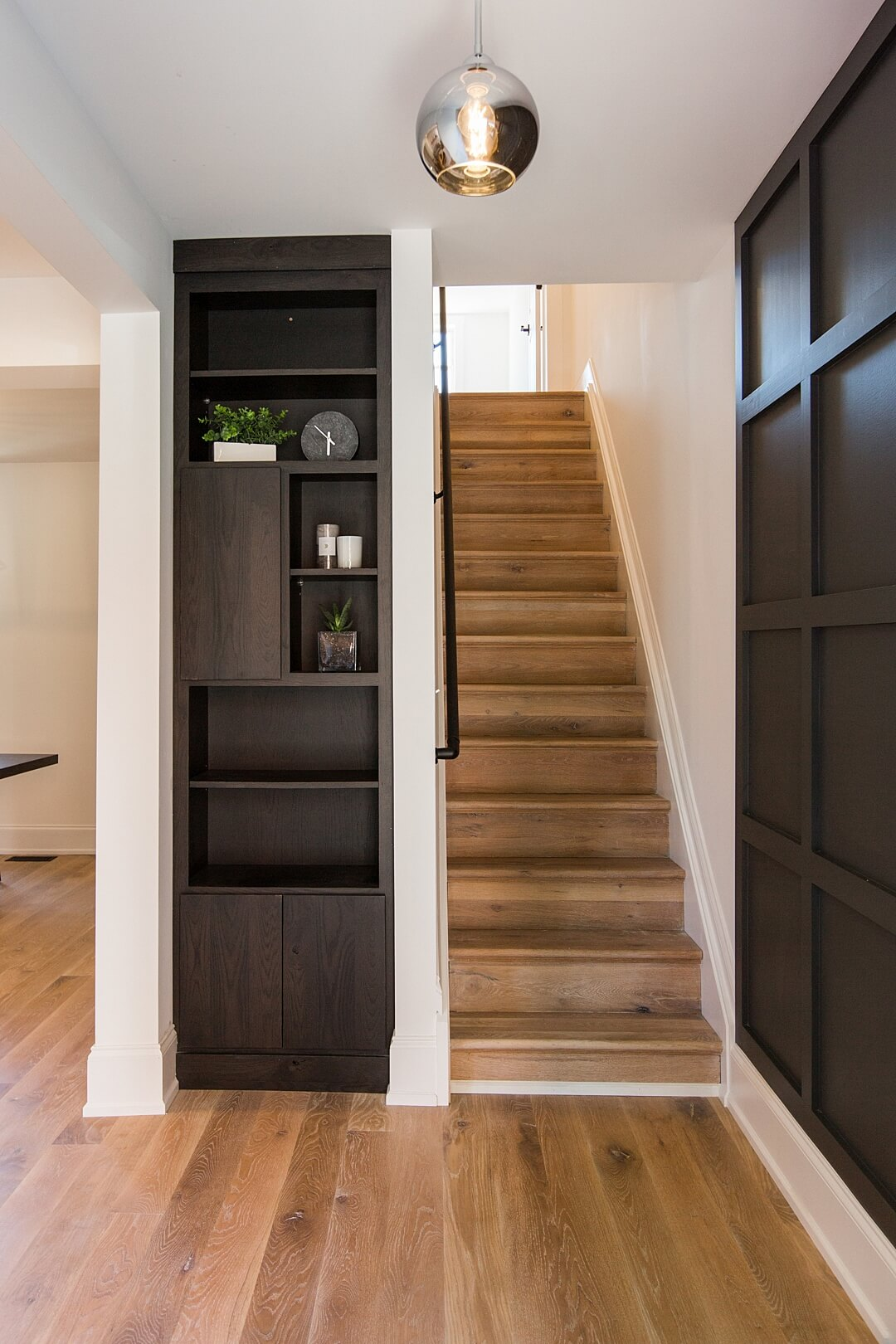 Oak stair treads leading upstairs in a house.