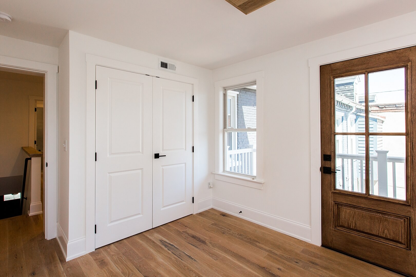 Entryway in a house with white oak flooring finished with matte floor finish.