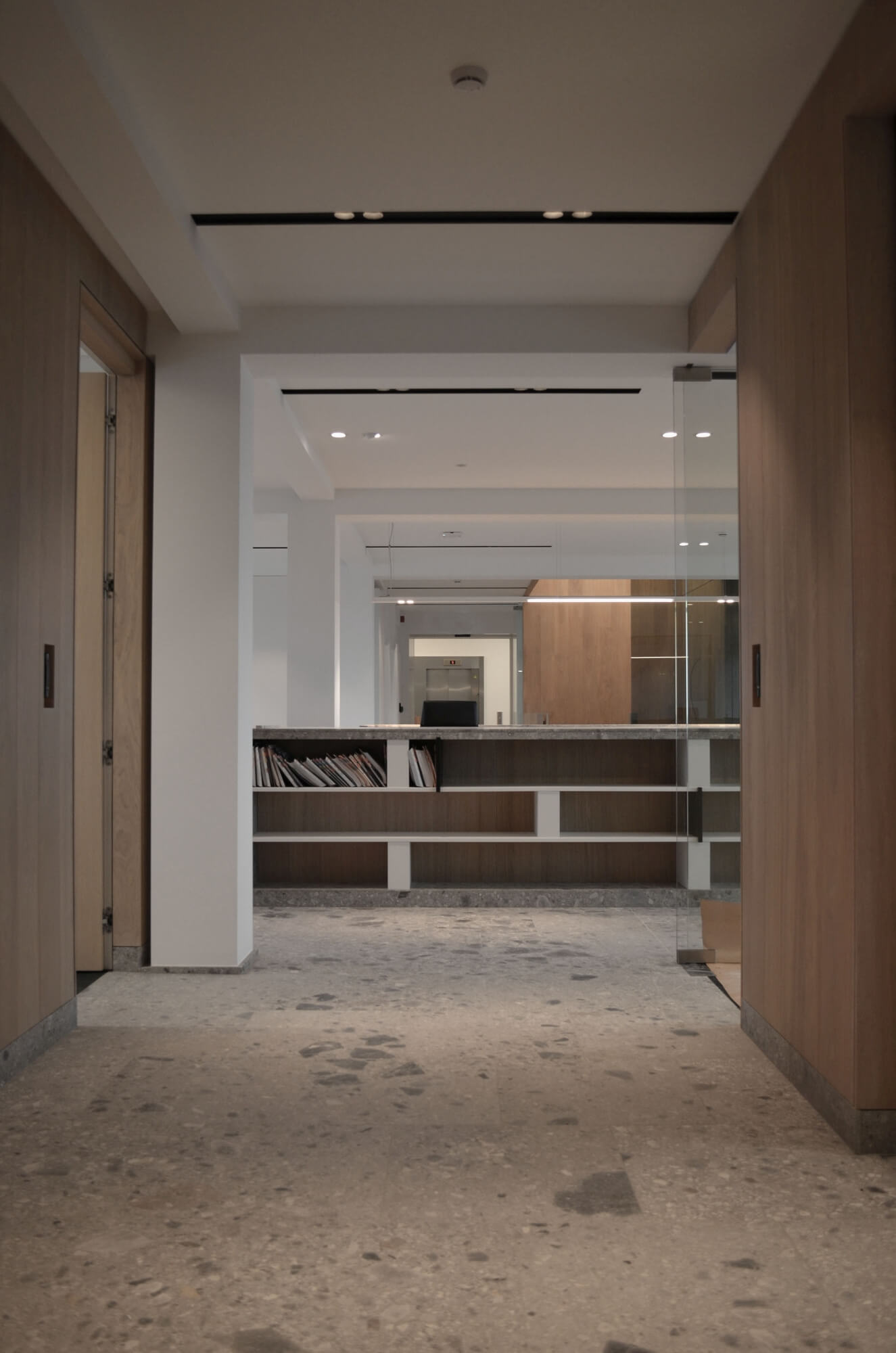 Interior designed office space with wood cabinets and stone flooring.