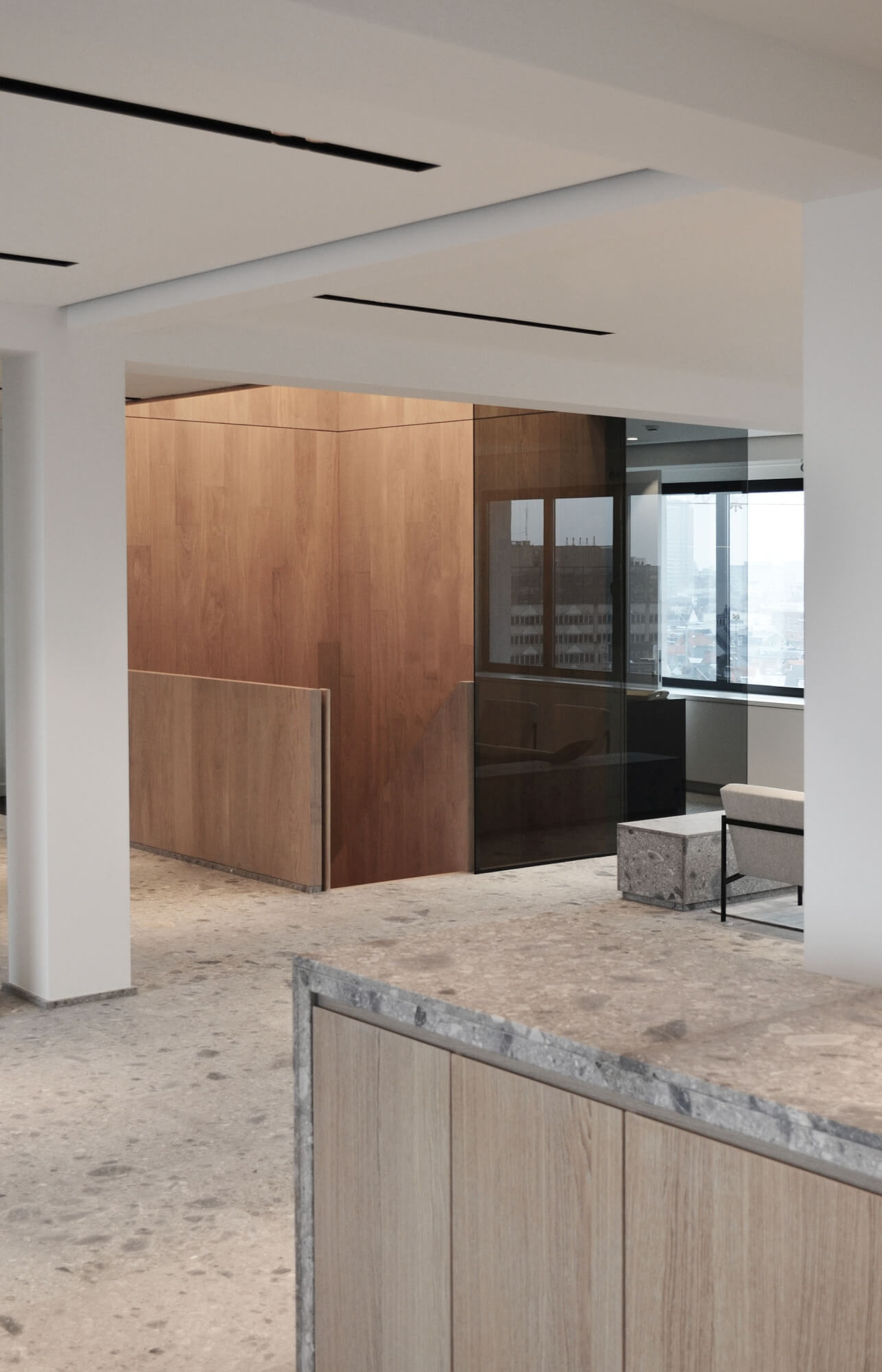 Interior designed office space with wood and stone elements.