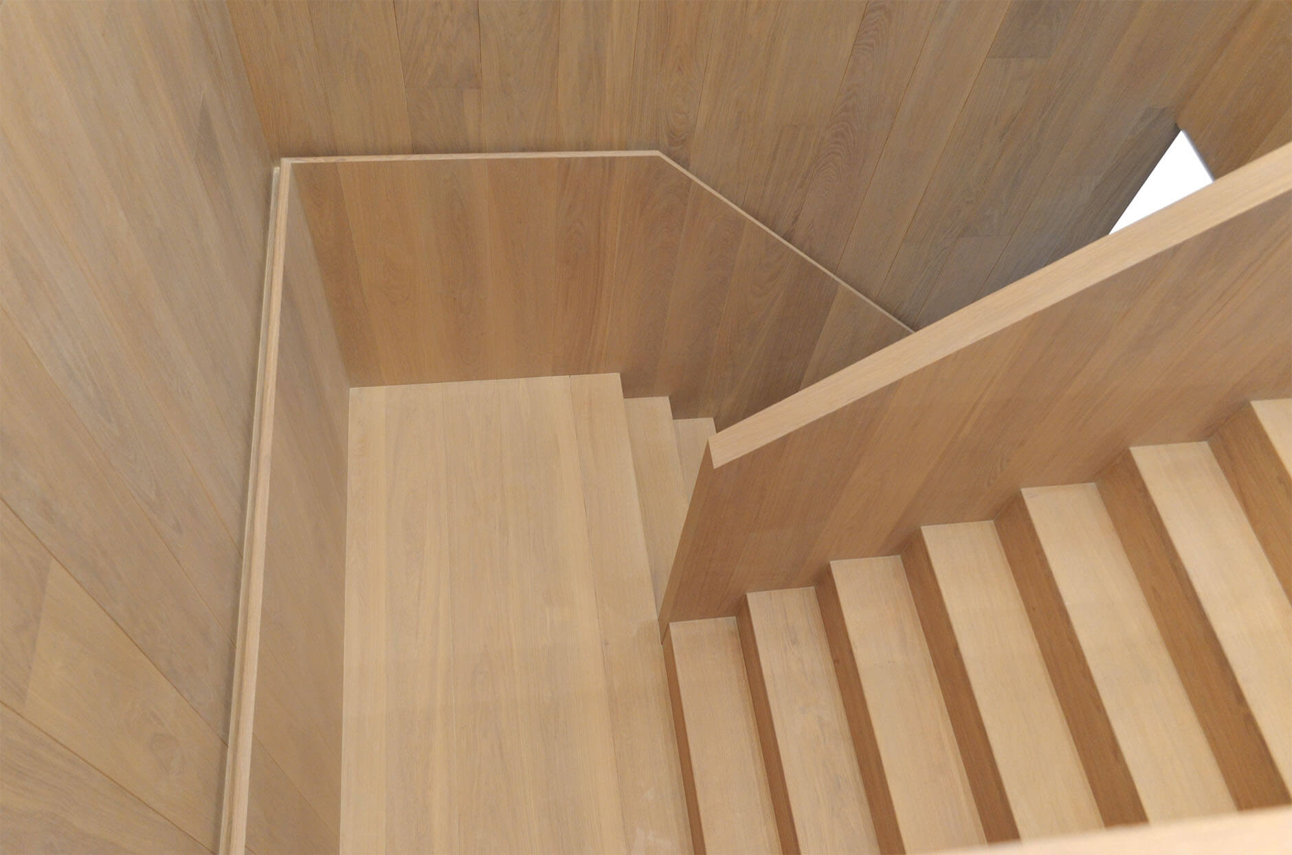 Wood staircase in an office building with natural looking oak wood.