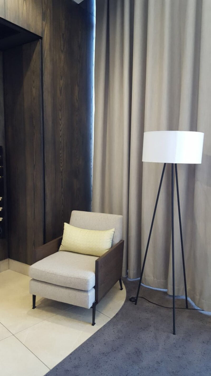 Lamp in high rise building with wood wall cladding.