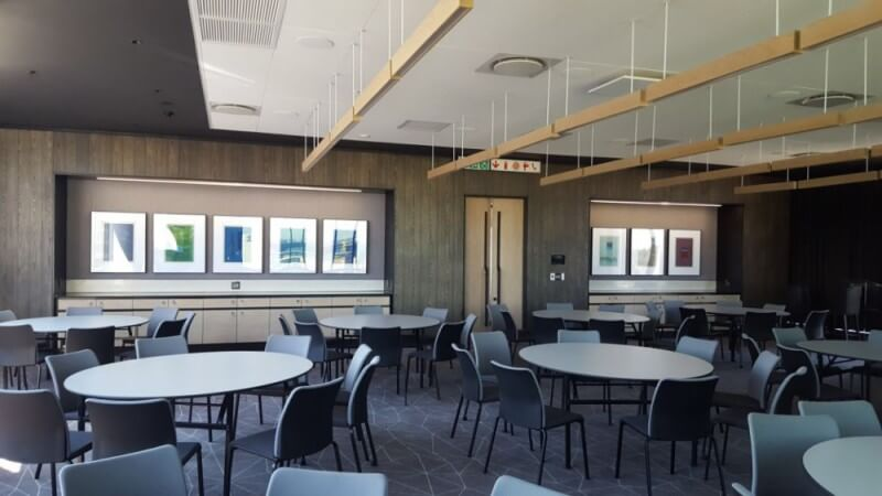Wood panels using in company cafeteria design.
