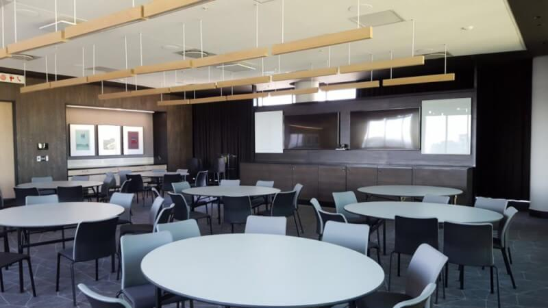 Cafeteria with wood panel designs.