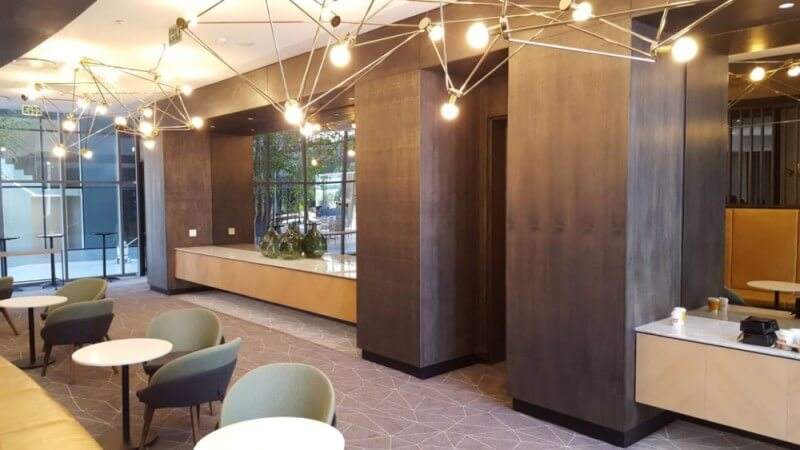 Wall cladding and cabinetry made out of wood in an office building.