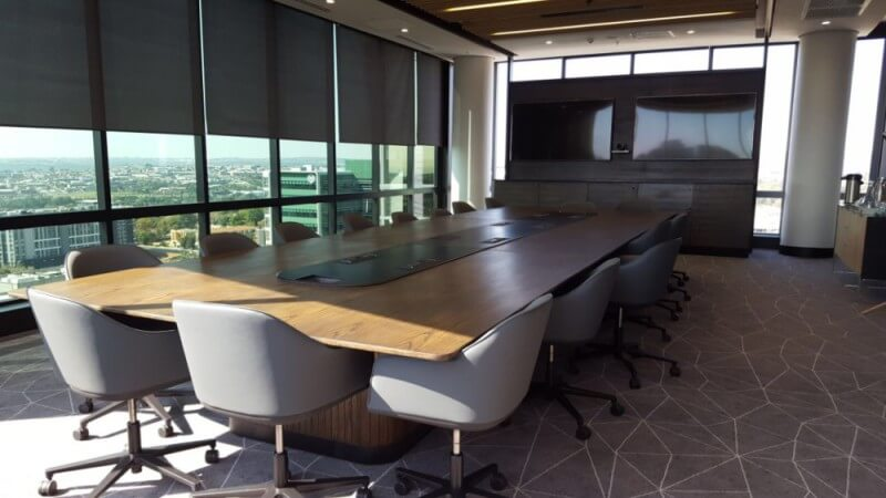 Conference room with long conference table finished with durable matte finish hardwax oil wood finish.