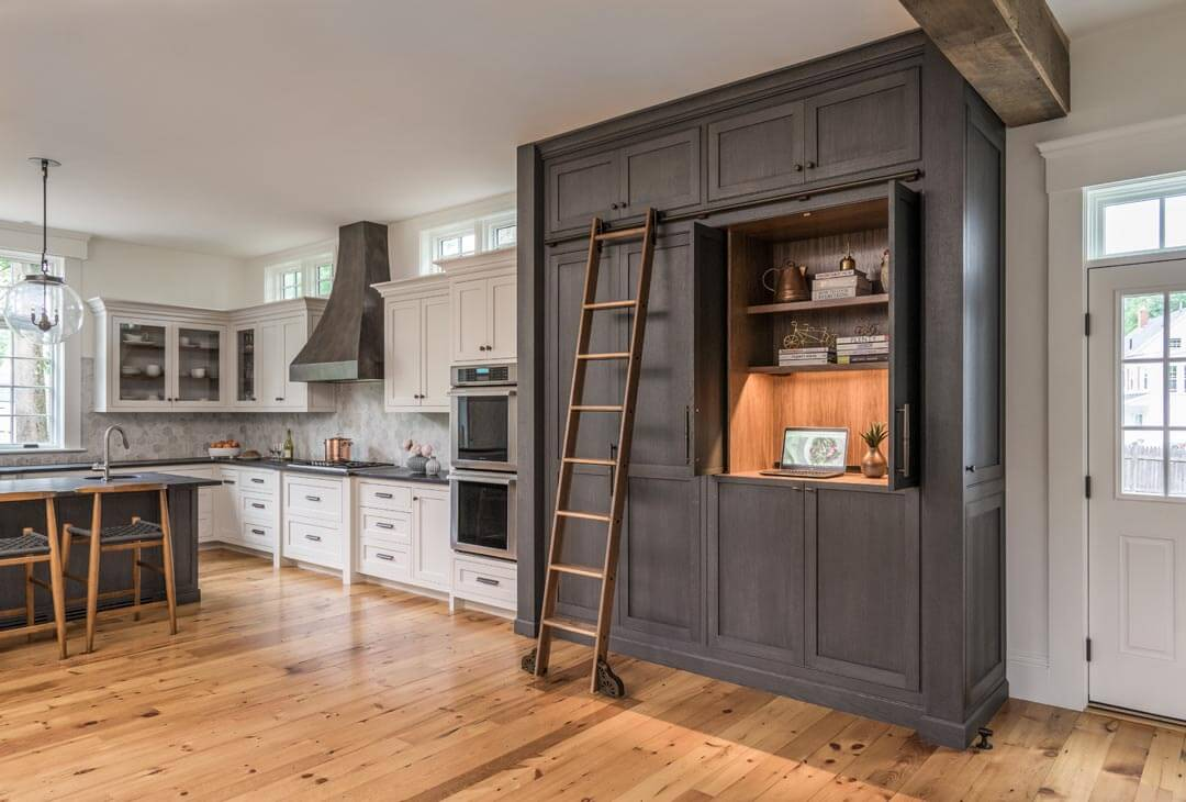 Custom stained rift and quartered white oak cabinetry in a kitchen.