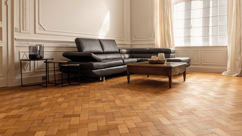 A Rubio Monocoat finished herringbone and parquet wood floor in a private home.