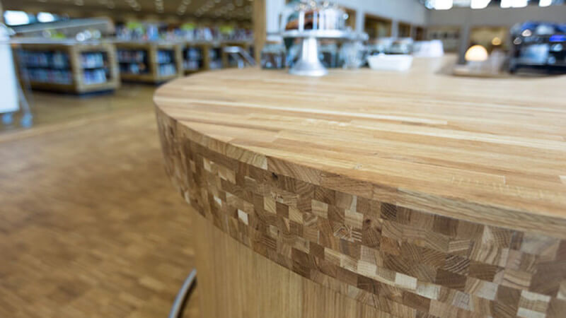 Unique details of a wooden counter at a library finished with Oil Plus 2C.