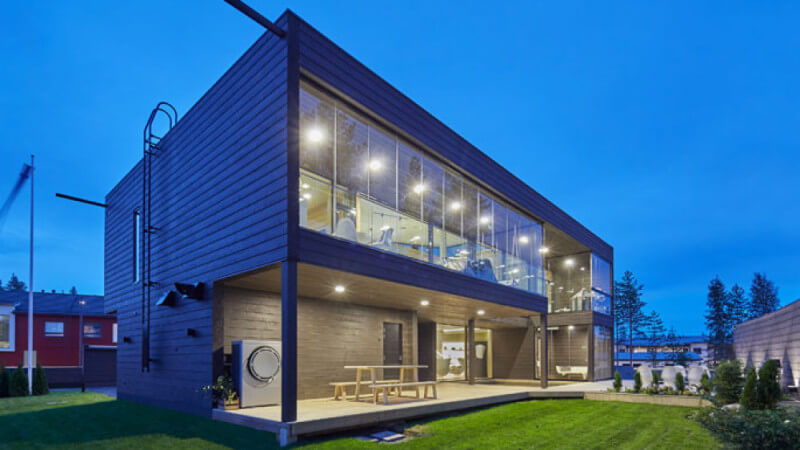 Modern architecture house with wood paneling at night.