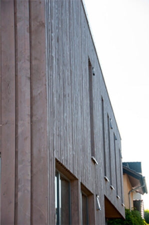 Exterior wood finish on wood paneled building.