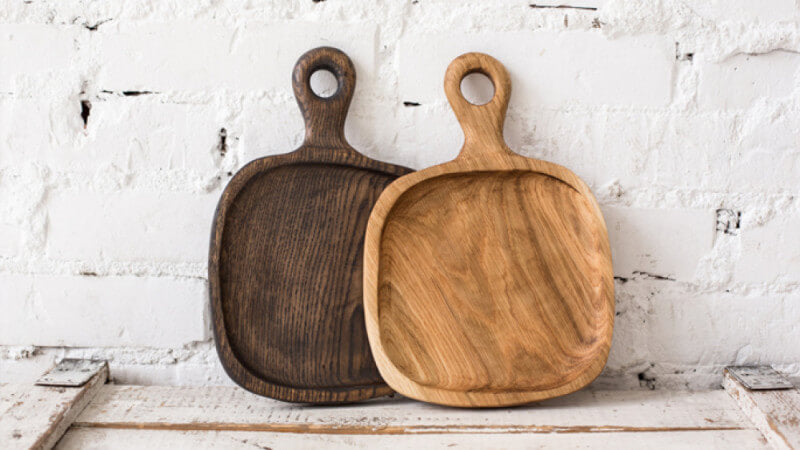 Two wood serving trays that are finished with a food safe finishing oil.