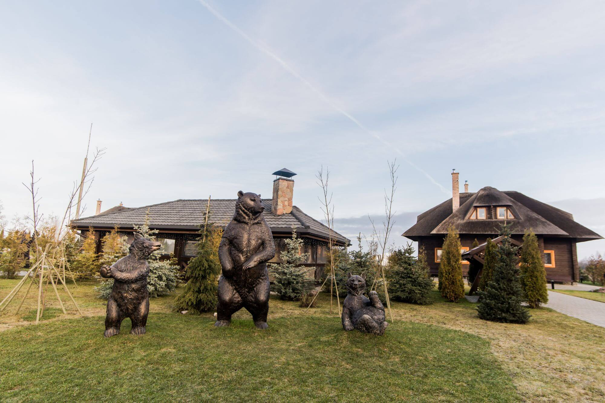 Front of property that features three bear statues and many wood features finished with Rubio Monocoat.