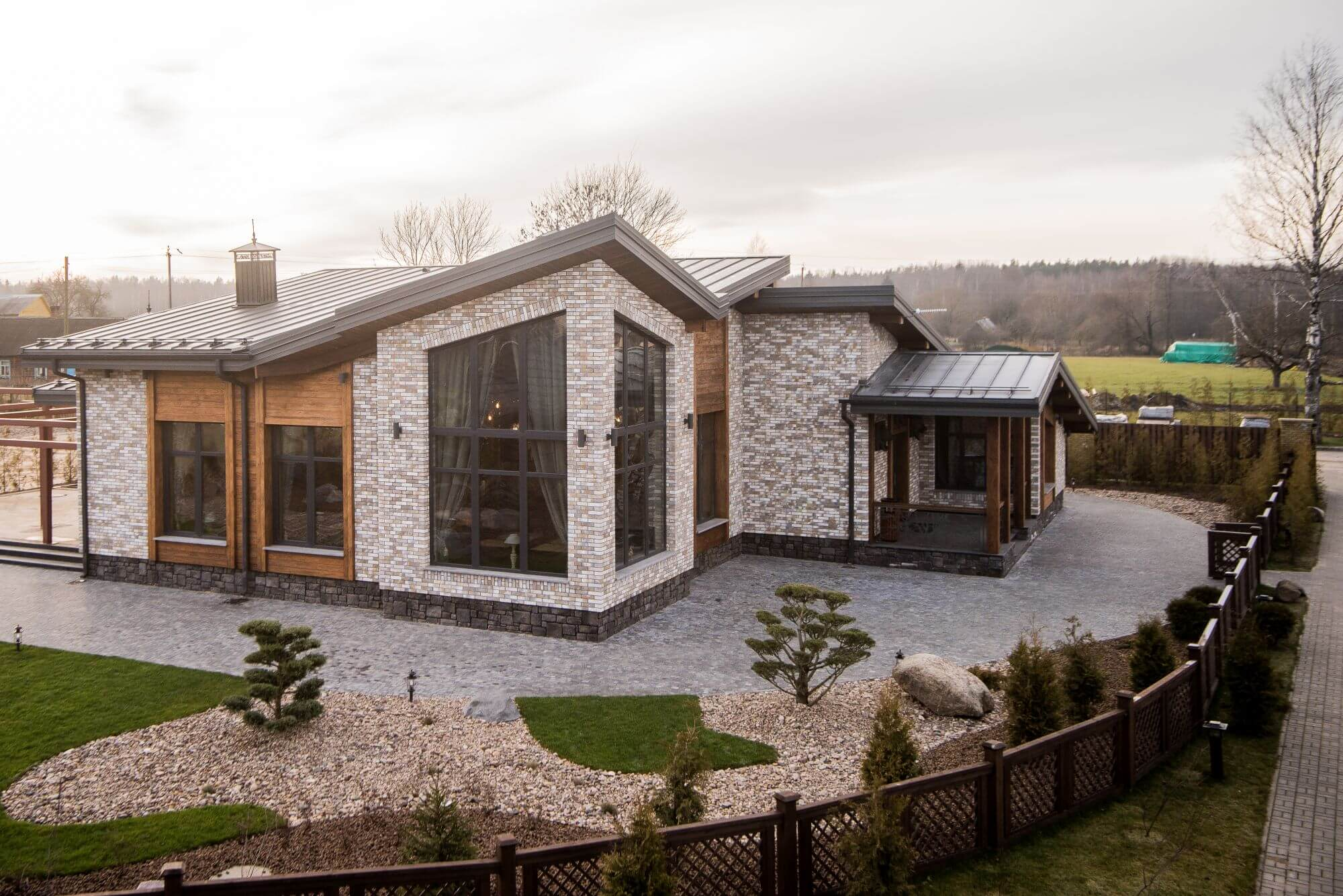 Beautiful home features exterior wood cladding finished with Rubio Monocoat Hybrid Wood Protector.