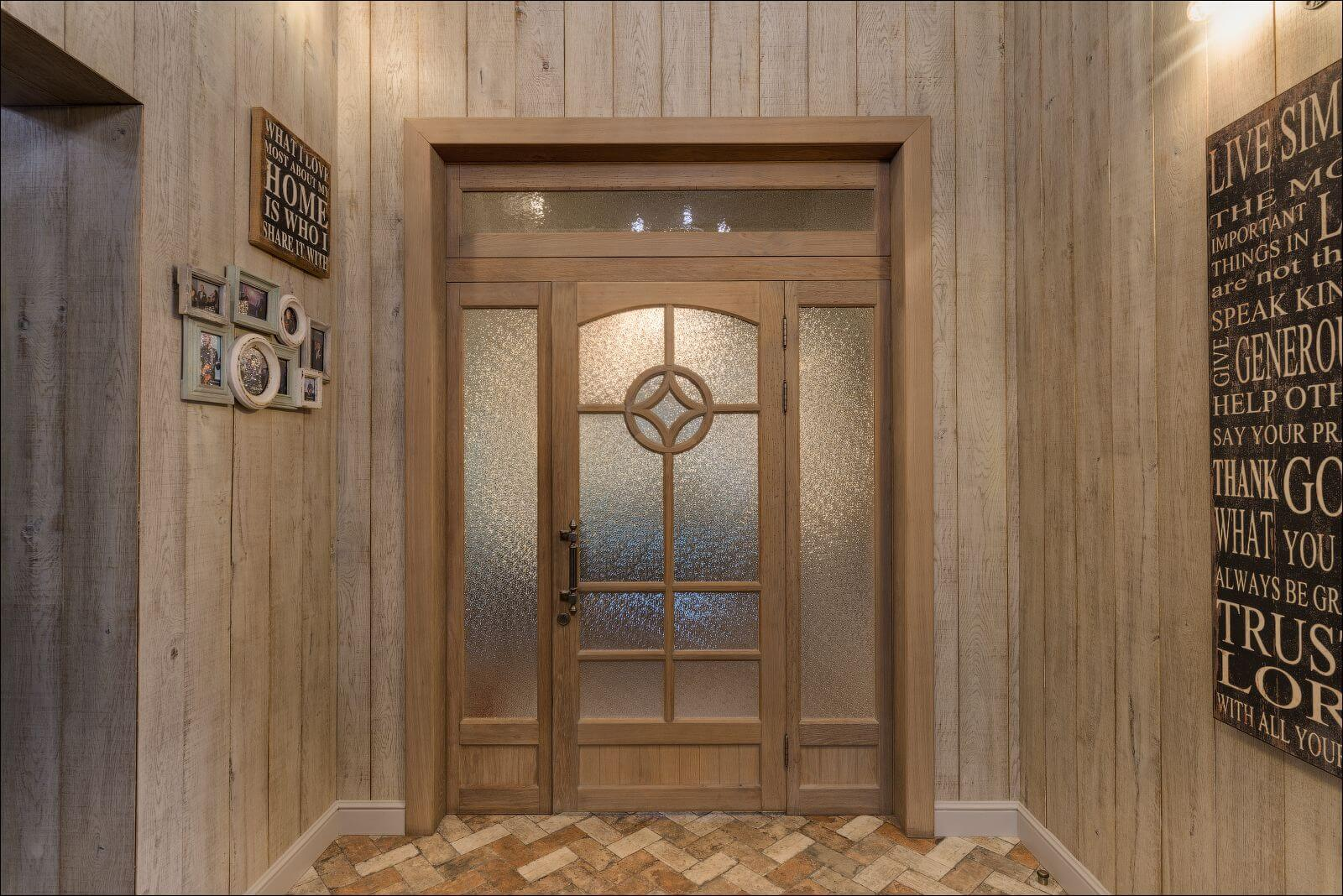 Beautiful wooden doorway and wooden clad walls finished with Rubio Monocoat.
