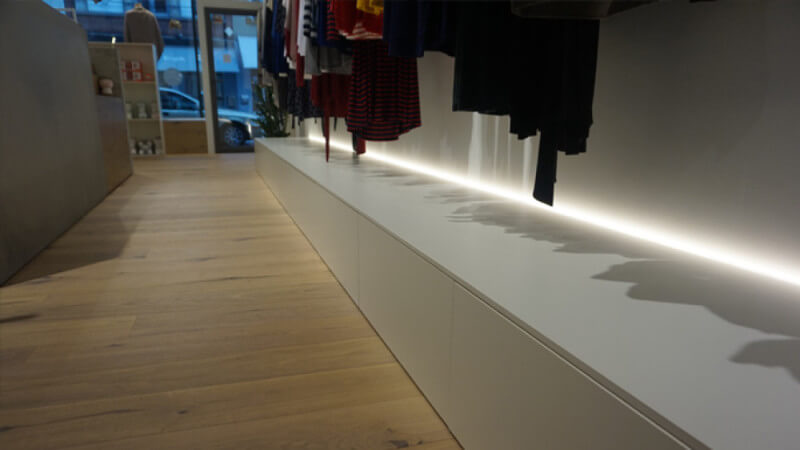 Wooden floors in a clothing store finished with Rubio Monocoat Oil Plus 2C.