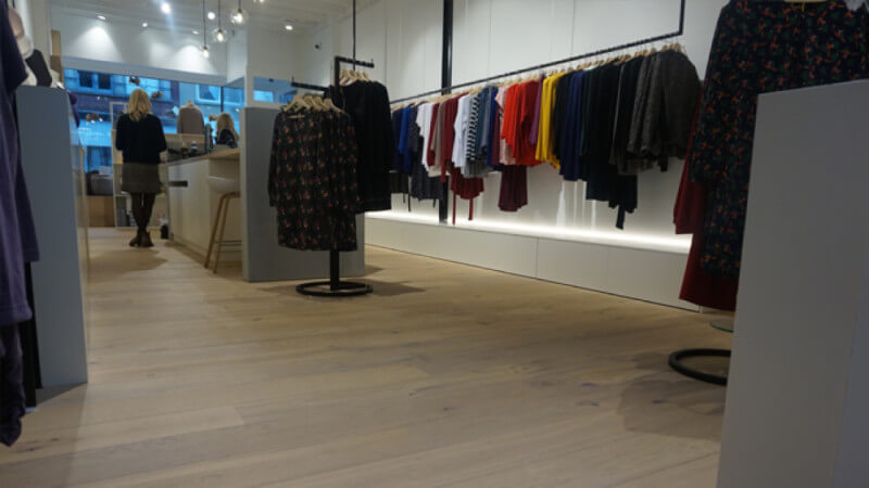 Wooden floors in a clothing store finished with a hardwax oil from Rubio Monocoat.