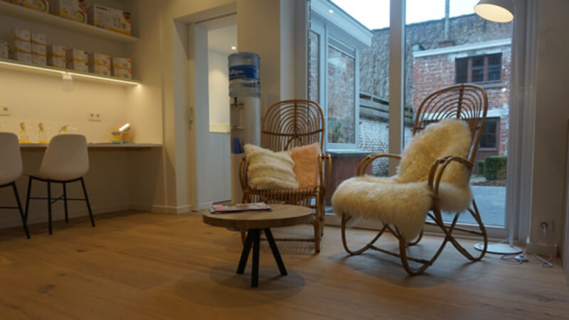 Unique rocking chairs in clothing store sitting on wooden floors finished with Rubio Monocoat.