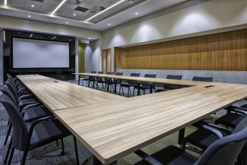 Conference room with massive wooden table finished with Rubio Monocoat.