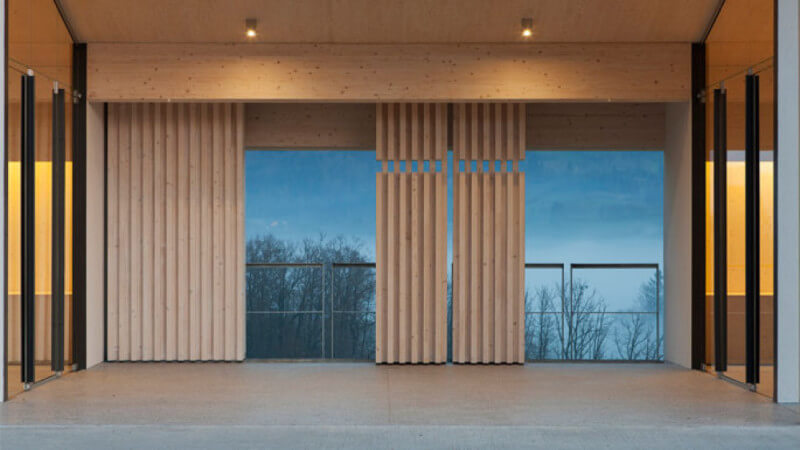 Vertical wooden accent panels used in a building.