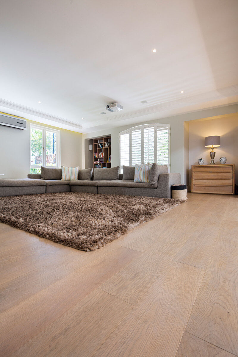 Wide plank hardwood floors in a living room.