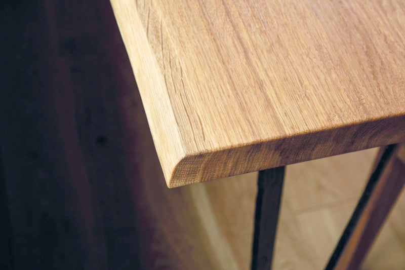 Details of oak wooden table finished with Rubio Monocoat hardwax oil called Oil Plus 2C.