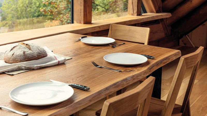 Wooden live edge dining table finished with Rubio Monocoat.