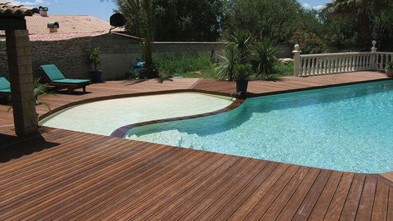 A pool and new Ipe wood deck finished with hardwax oil wood finish.