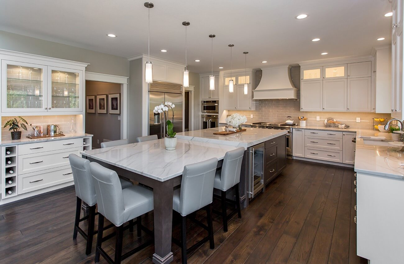 Kitchen design with dark hardwood flooring and light cabinetry.