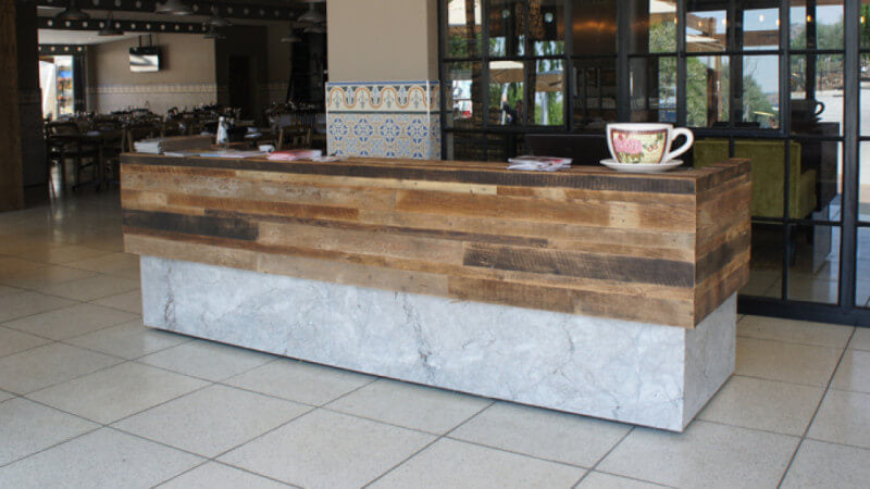 A counter made form concrete and rustic wood, finished with hardwax oil wood finish.