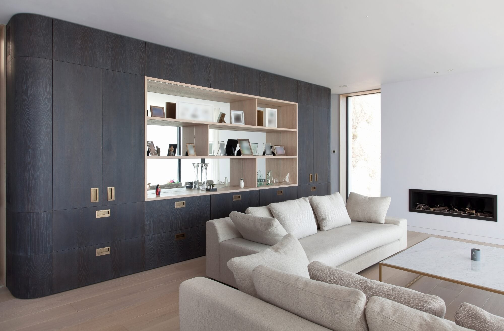 Built in wall cabinets stained dark using eco-friendly wood finish.