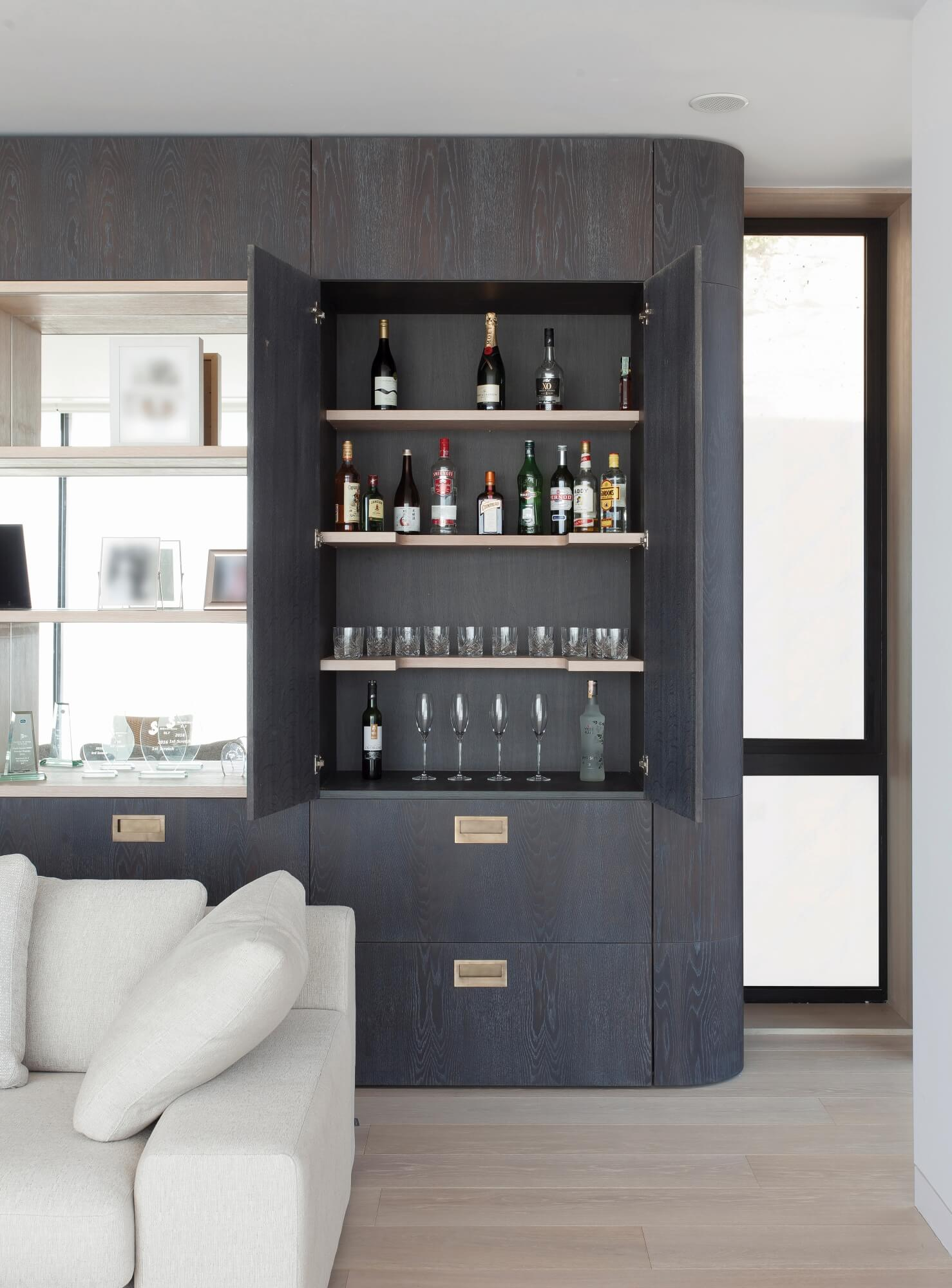Wall cabinets with build in liquor cabinet.