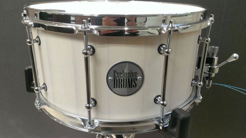 A custom wood drum with a white matte wood finish.