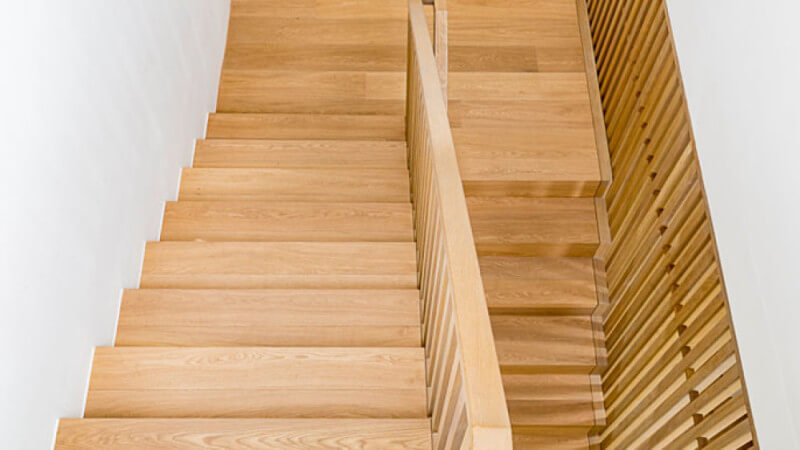 Oak stair treads with a durable natural wood finish on them.
