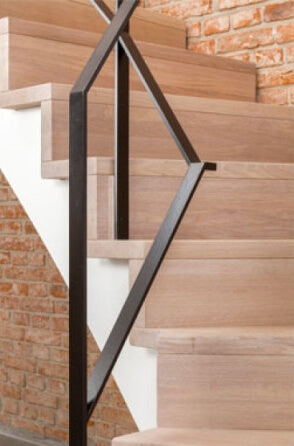 A detail shot of oak stair treads finished with a natural wood oil finish.