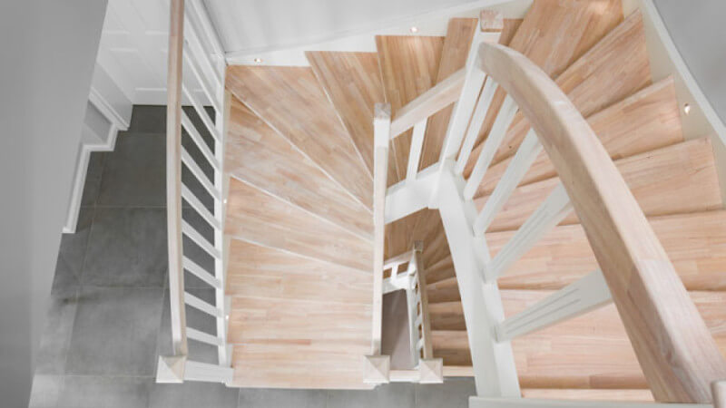 A top down view of stair treads finished using a durable, natural, plant-based hardwax oil wood finish.