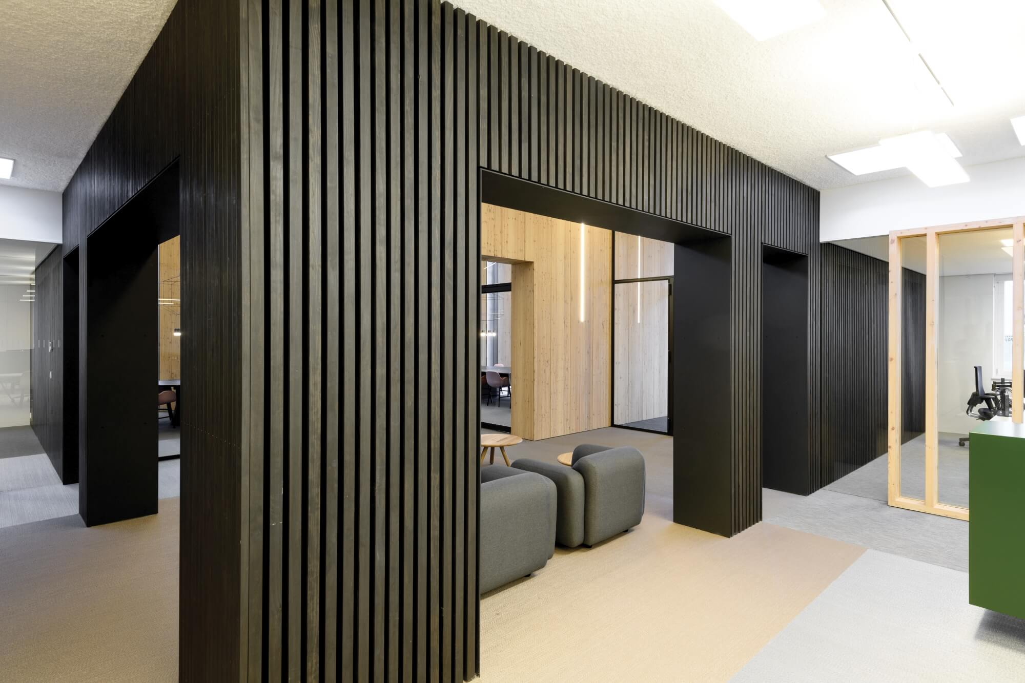 Office architecture with wood slats finished in dark wood finish.