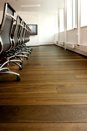 Hardwax oil finished oak wood flooring in a conference room.