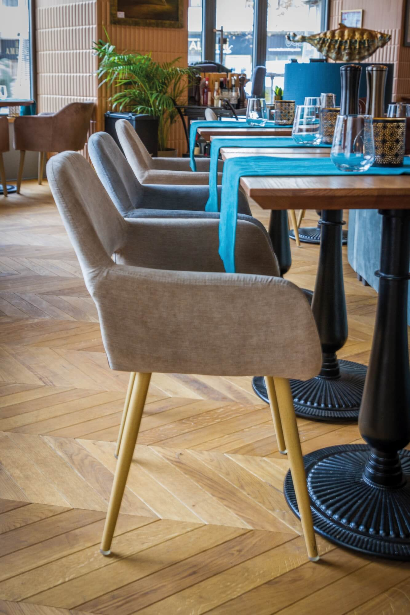 Chevron hardwood flooring in a restaurant with tables and chairs.