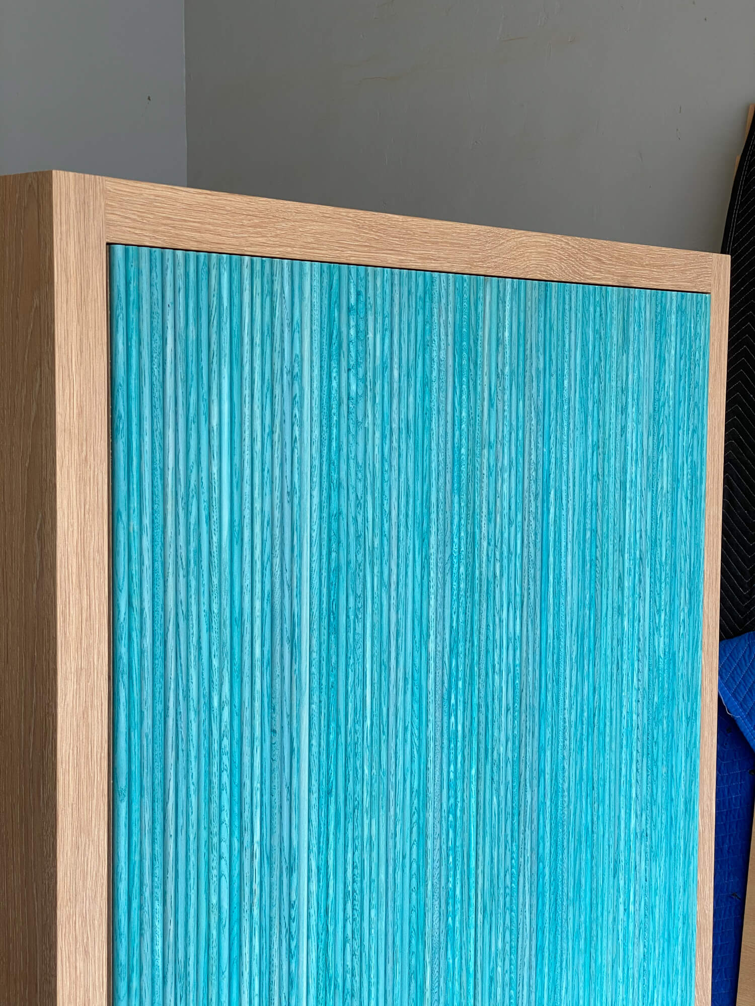 Unique texture to wooden entry cabinet.