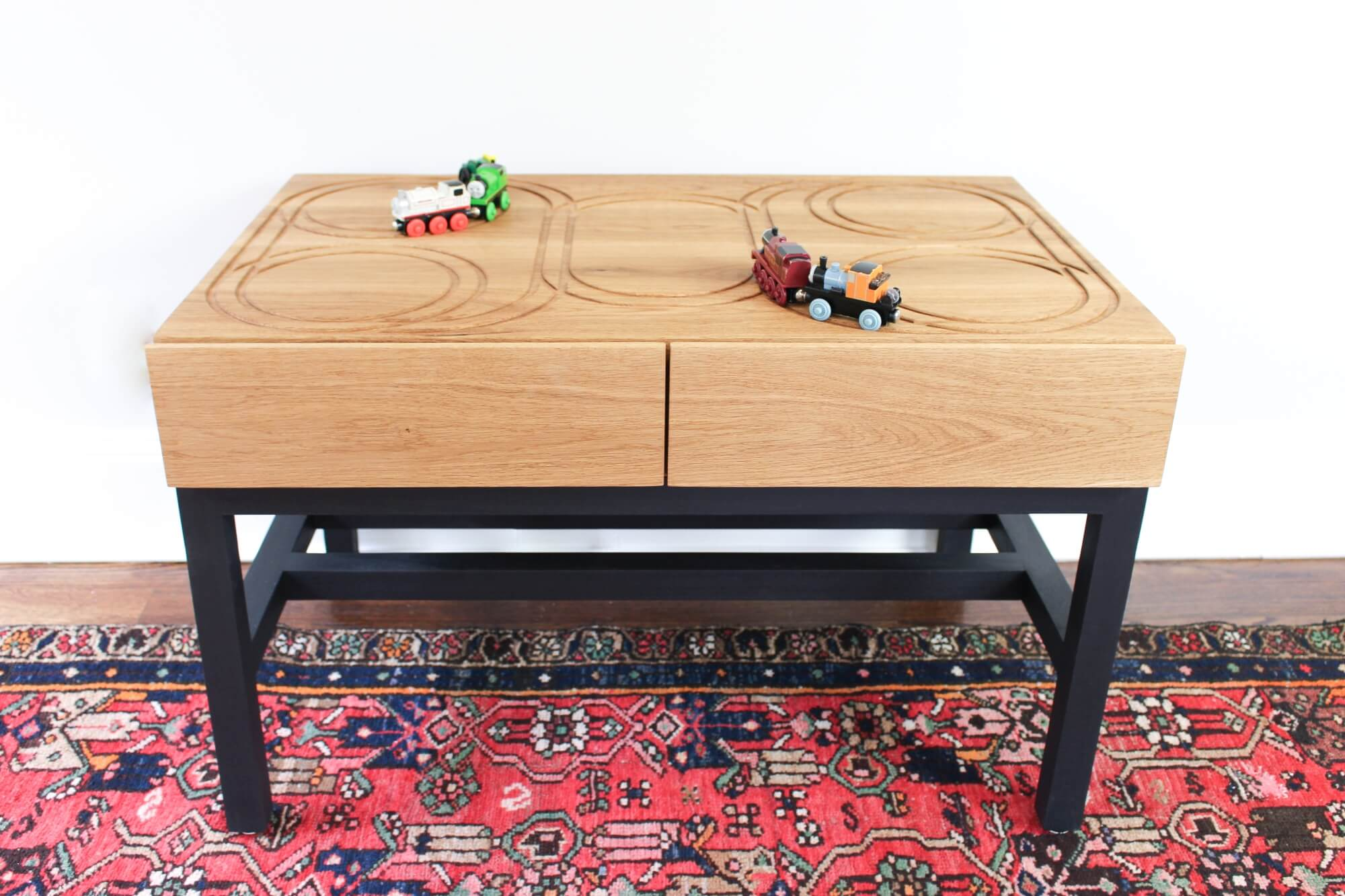 DIY wood toy train table finished with toy safe wood finish.