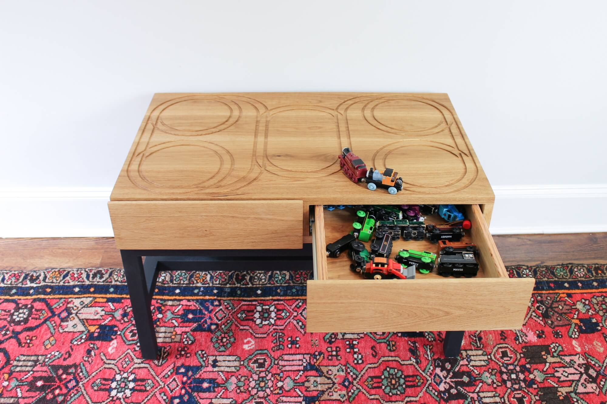 DIY train table finished with a toy safe wood finish.