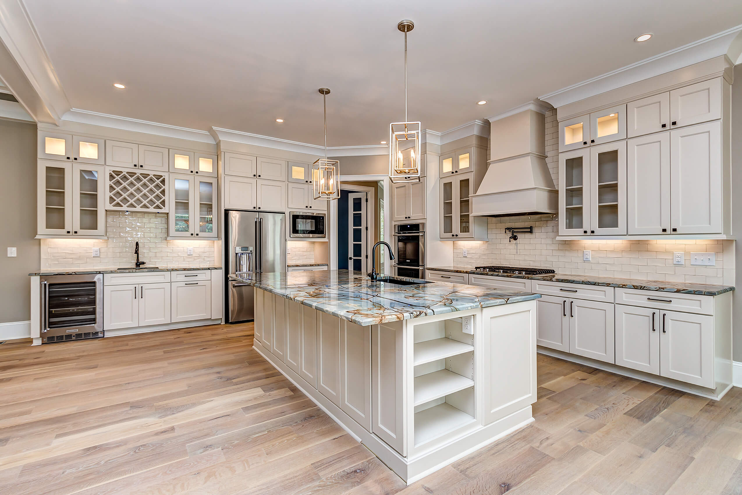 Kitchen features engineered white oak floors finished with Rubio Monocoat Oil Plus 2C.