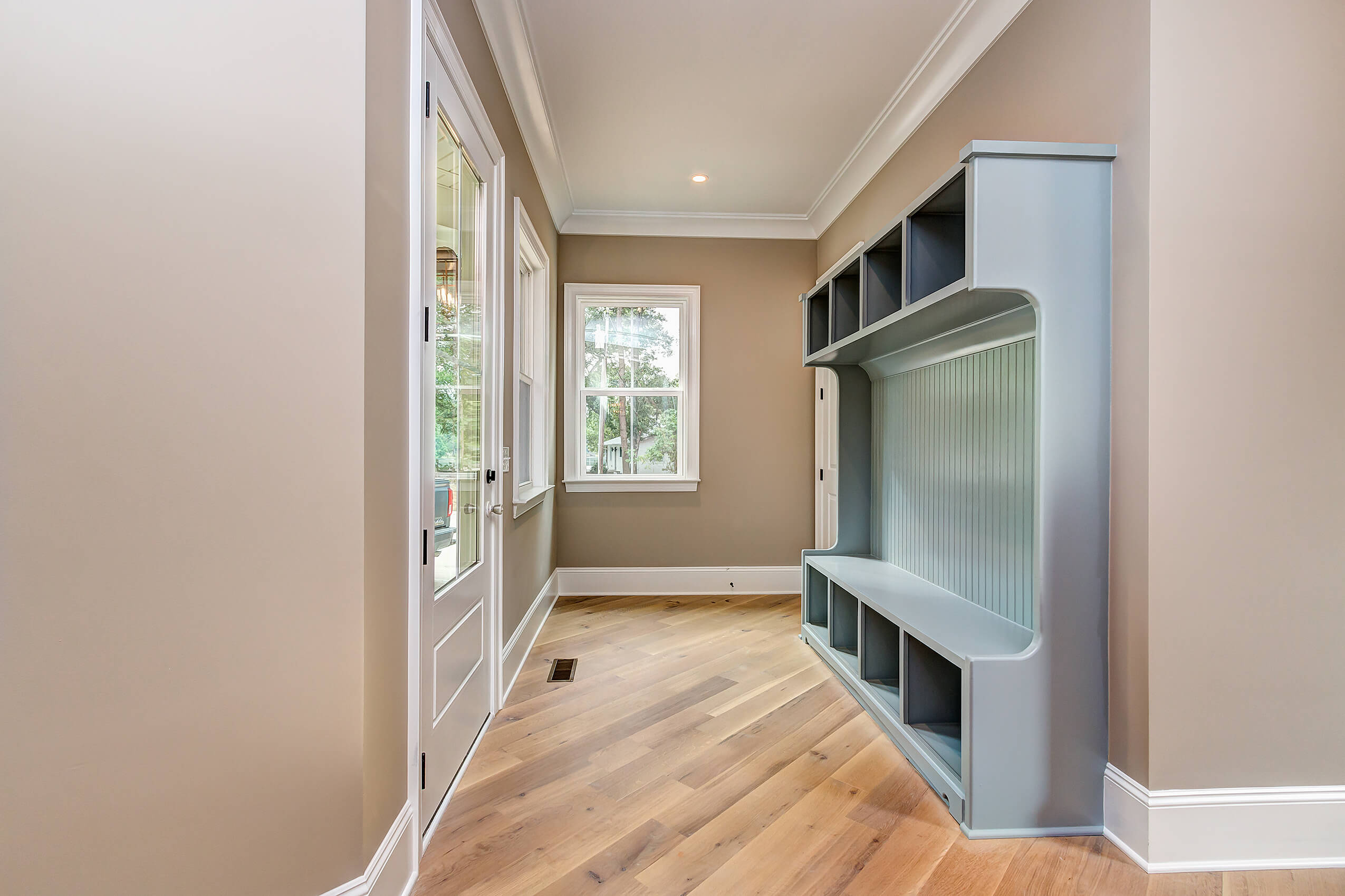 Entry way with engineered white oak floors finished with Rubio Monocoat Oil Plus 2C.