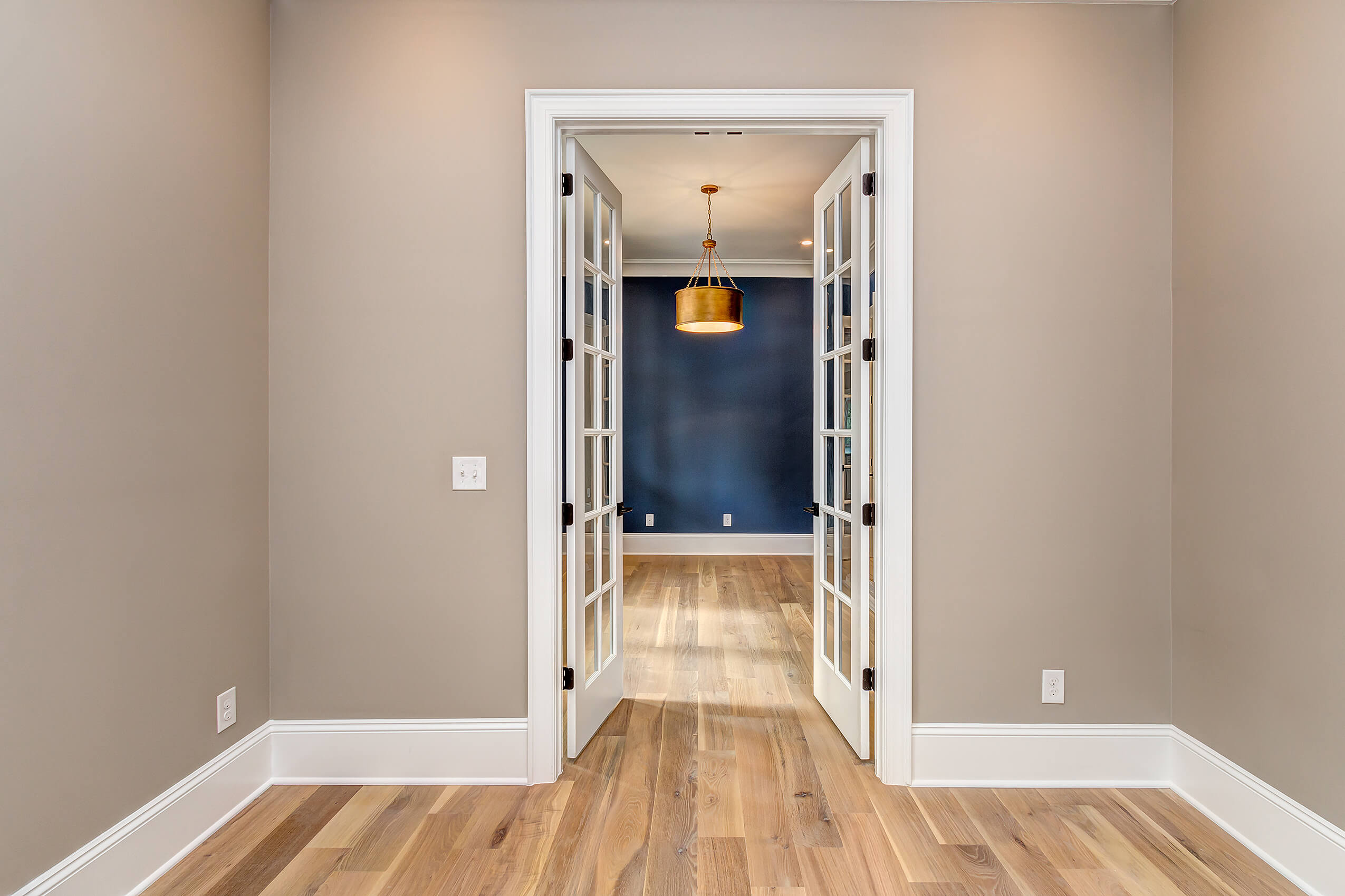 Door way in a house featuring white oak floors finished with Rubio Monocoat Oil Plus 2C.